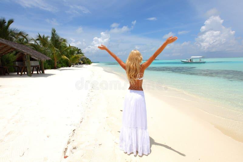 Happy woman on the ocean coast