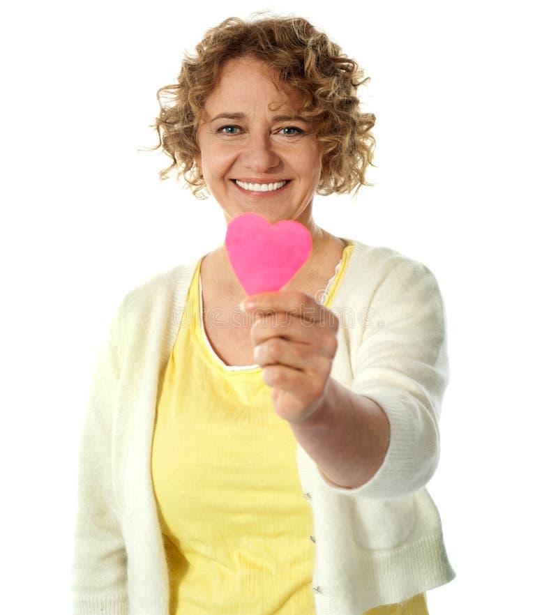 Happy woman offering her heart