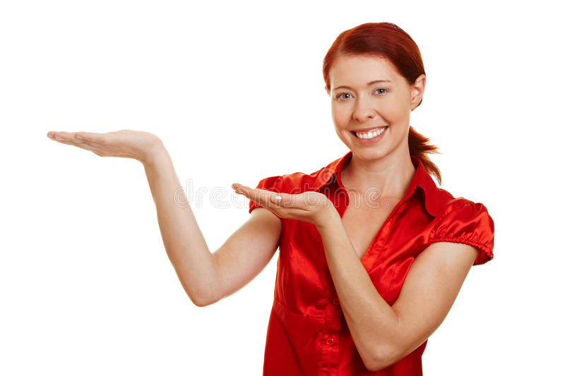 Happy woman offering imaginary stock photo