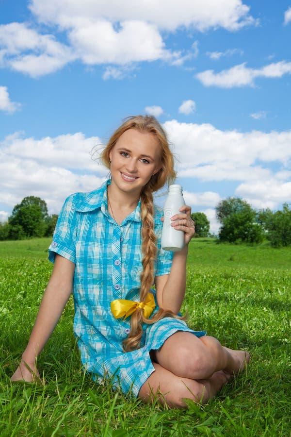 Happy woman offering milkshake royalty free stock photo