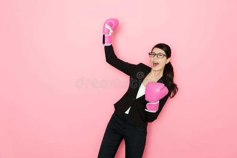 Happy woman office worker wearing boxing gloves stock images