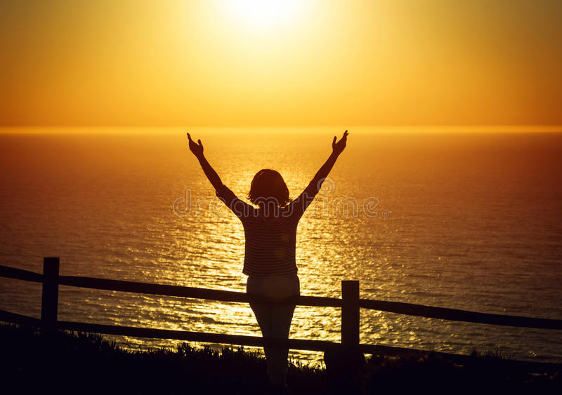 Download Happy Woman Open Arms Under The Sunset At Seaside Stock Photo - Image: 83723696