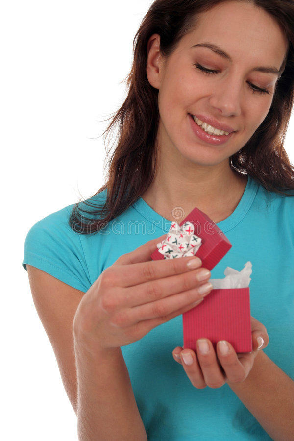 Happy Woman Opening Present Stock Photography