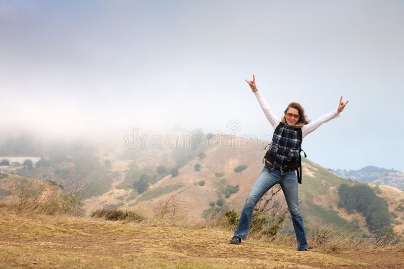Happy woman outdoors. Happy young woman exploring Northern California. San Francisco, Golden Gate vista point, USA stock images