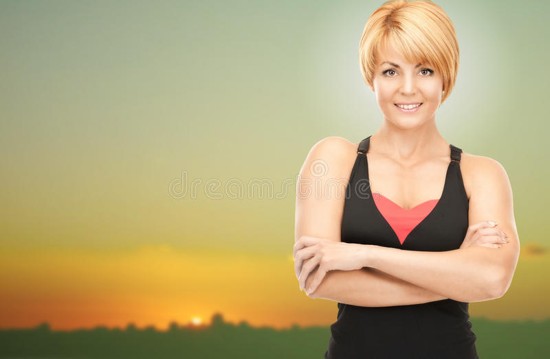 Happy woman outdoors over sunset skyline royalty free stock photography