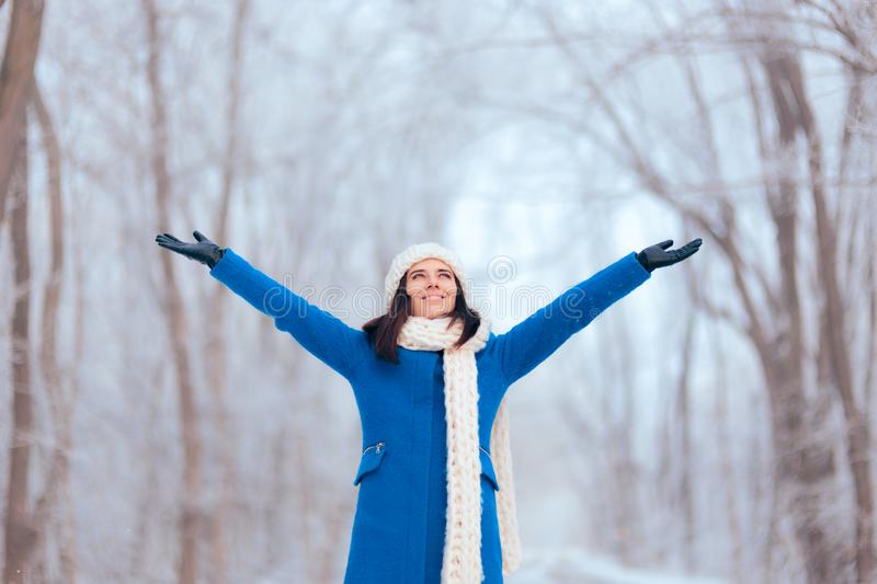 Happy Woman with Outstretched Arms in Winter Landscape stock photo