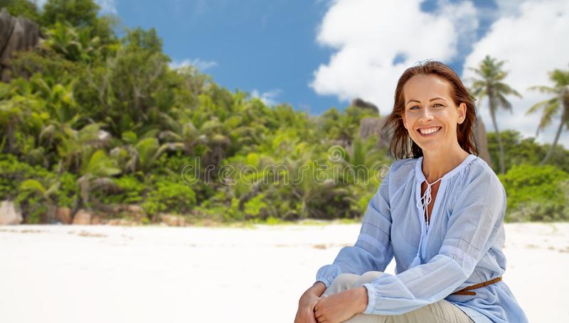 Happy woman over seychelles island tropical beach royalty free stock photo