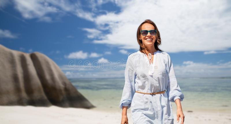 Happy woman over seychelles island tropical beach stock photography