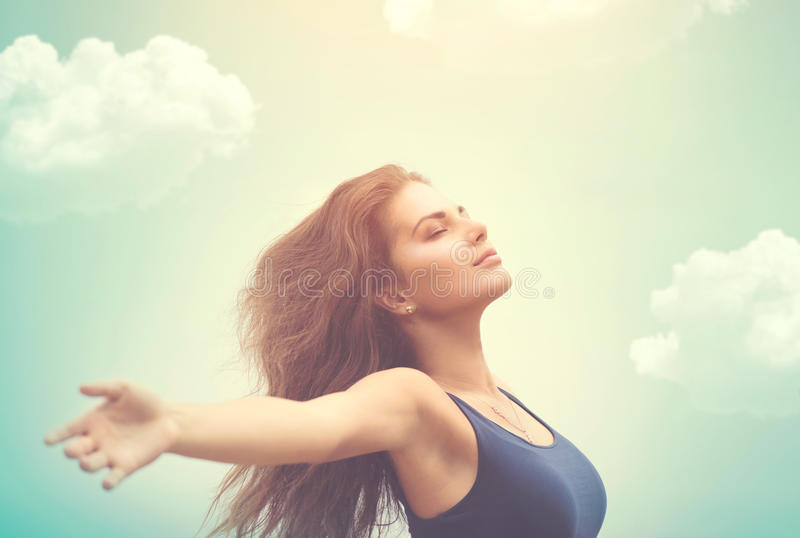 Happy woman over sky and sun royalty free stock images