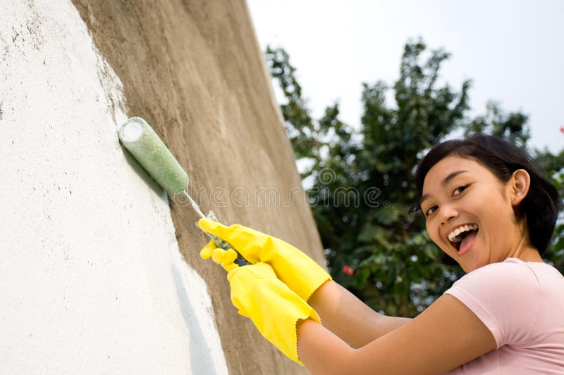 Happy woman painting royalty free stock photo