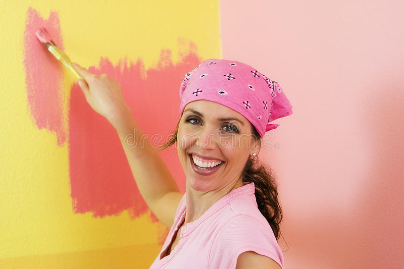 Happy Woman Painting Pink and Yellow stock image