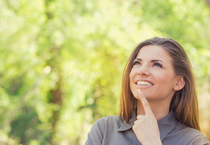 Happy woman in park on sunny autumn afternoon daydreaming stock images
