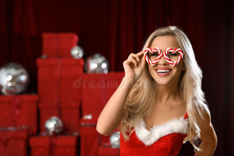 Happy woman with party glasses. Christmas celebration. Happy woman with party glasses indoors. Christmas celebration royalty free stock photo