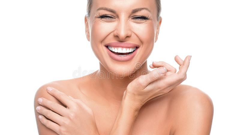 Happy woman with perfect skin isolated on white background. royalty free stock photos