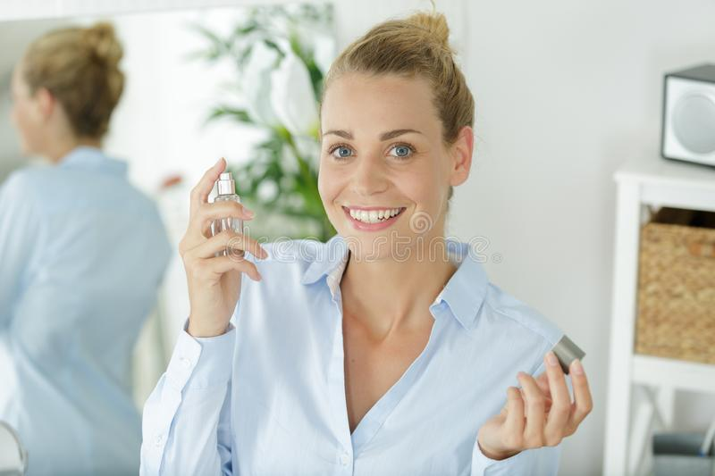 Happy woman with perfum. A happy woman with perfum stock photos