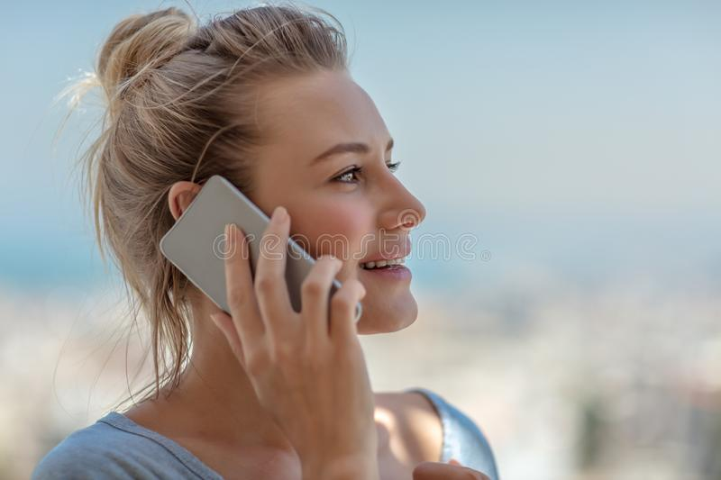 Happy woman on the phone royalty free stock photography