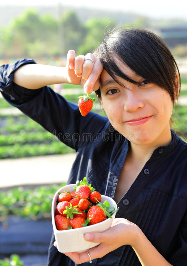 Happy woman pick strawberry. In farm royalty free stock photography