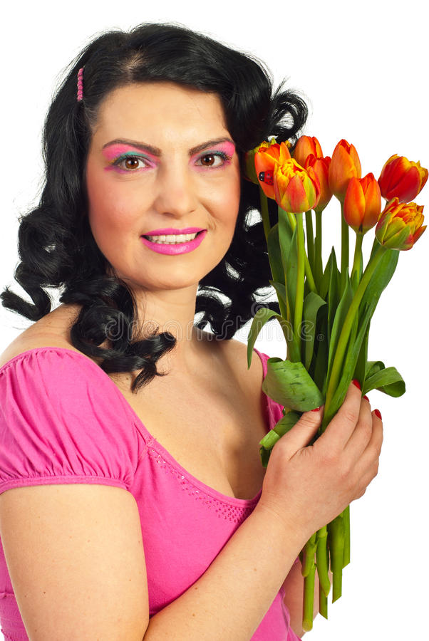 Happy woman in pink holding tulips