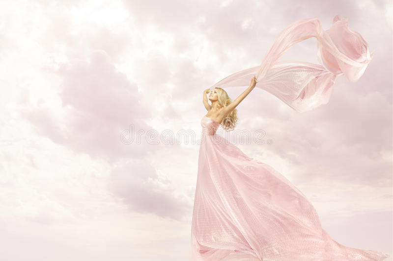 Happy Woman in Pink Long Dress, Girl Flying Silk Scarf Cloth royalty free stock photography