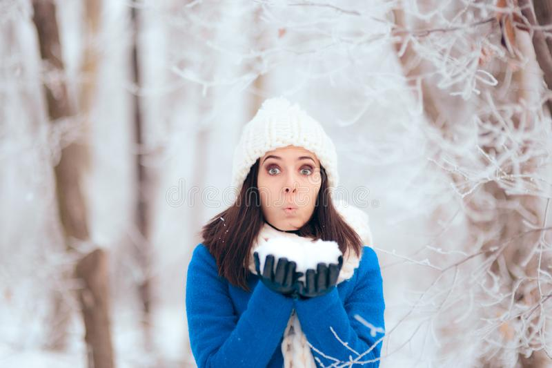 Happy Woman Playing with Snow Outdoors in Winter Portrait stock photography
