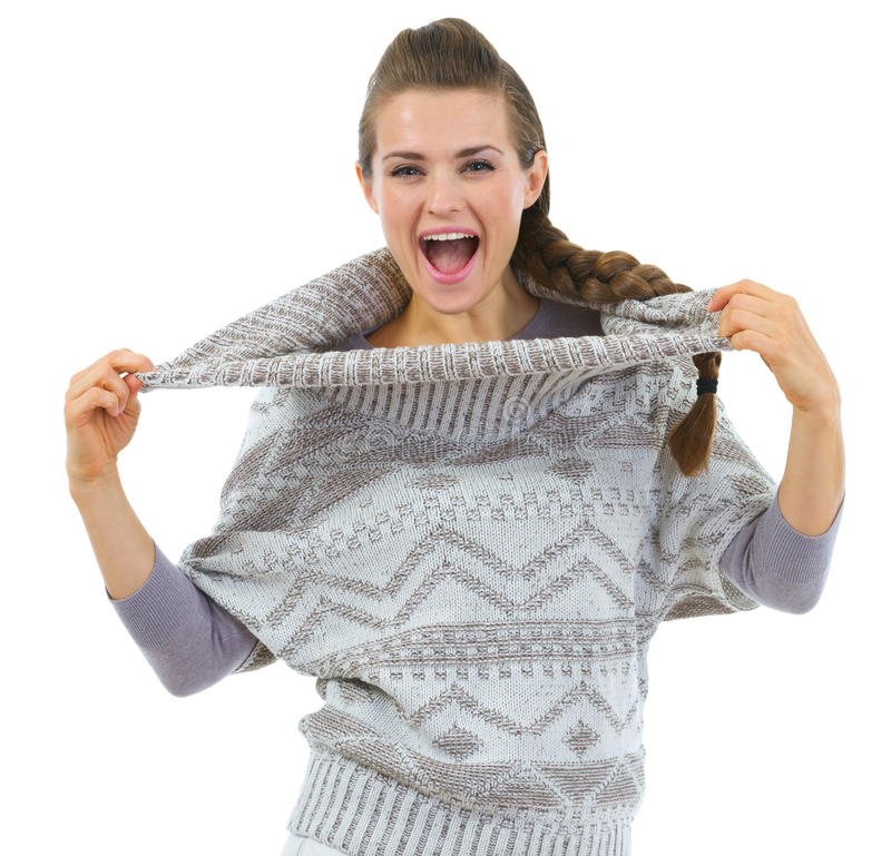 Happy woman playing with sweater collar. Isolated on white royalty free stock image