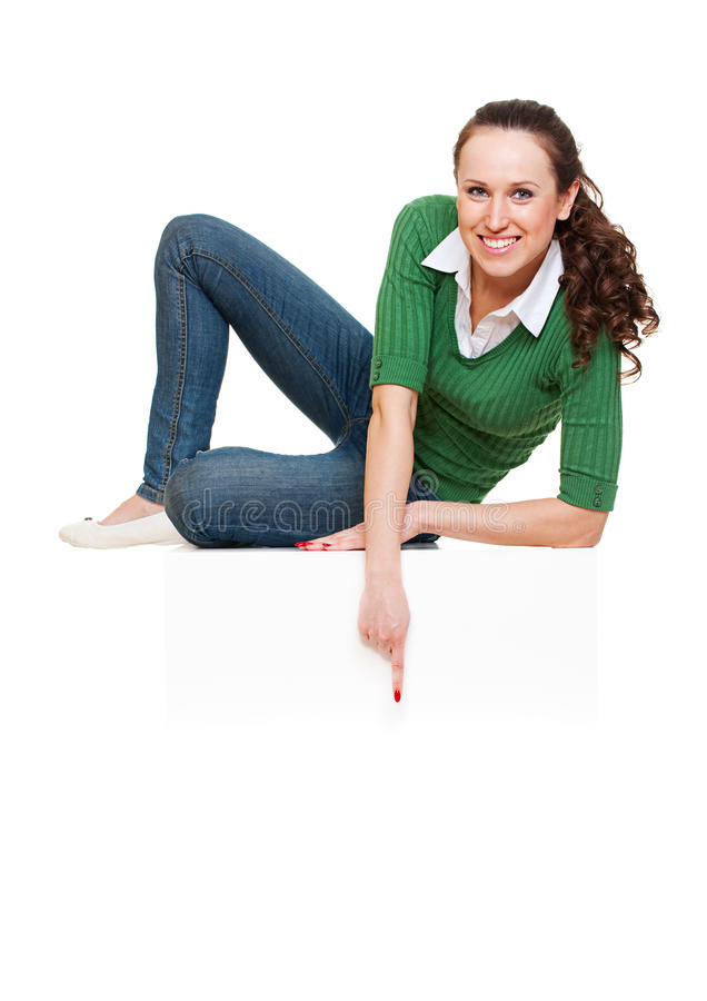 Happy woman pointing at something royalty free stock image