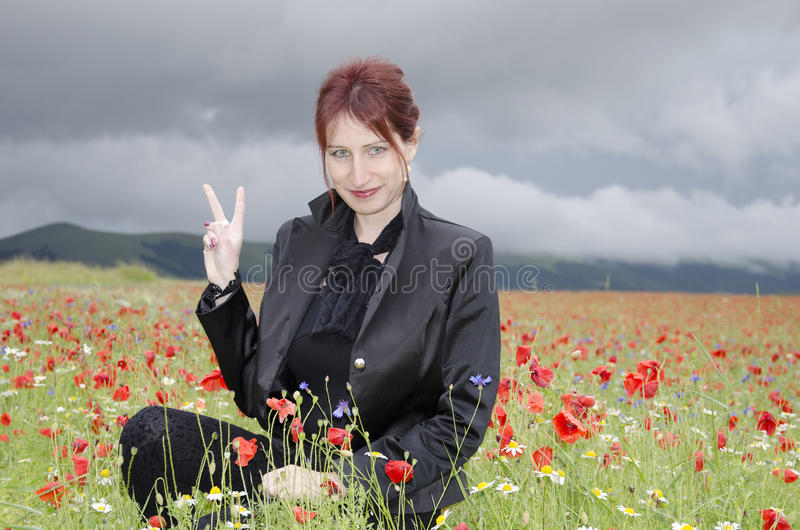 Happy woman on poppies field stock image