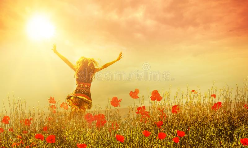 Happy Woman in Poppies stock image