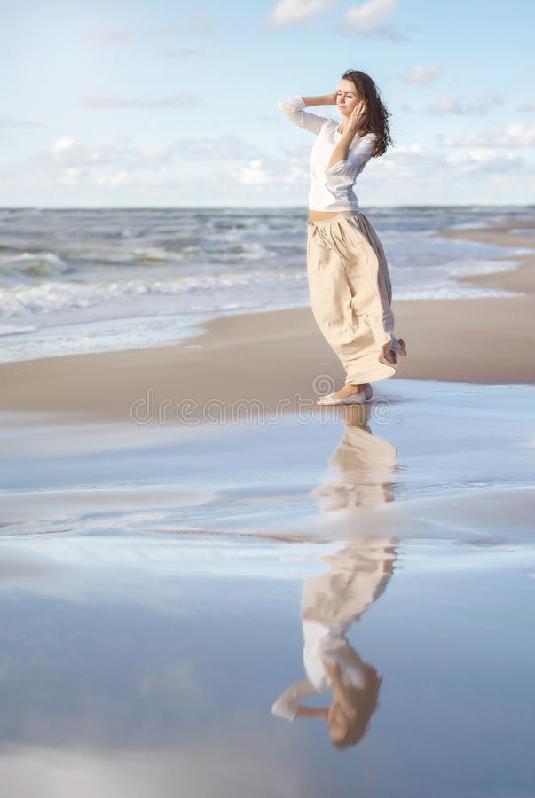 Free Happy Woman. Portrait Of The Beautiful Girl. Woman On The Beach. Wind Develops Hair. Royalty Free Stock Photo - 75610785