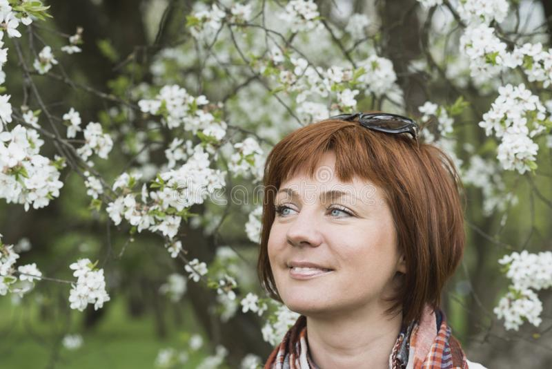 Woman in spring blossom royalty free stock photo