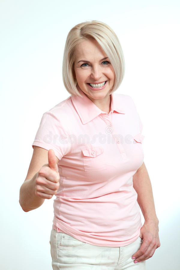 Happy woman portrait. Success. over white background. stock photos