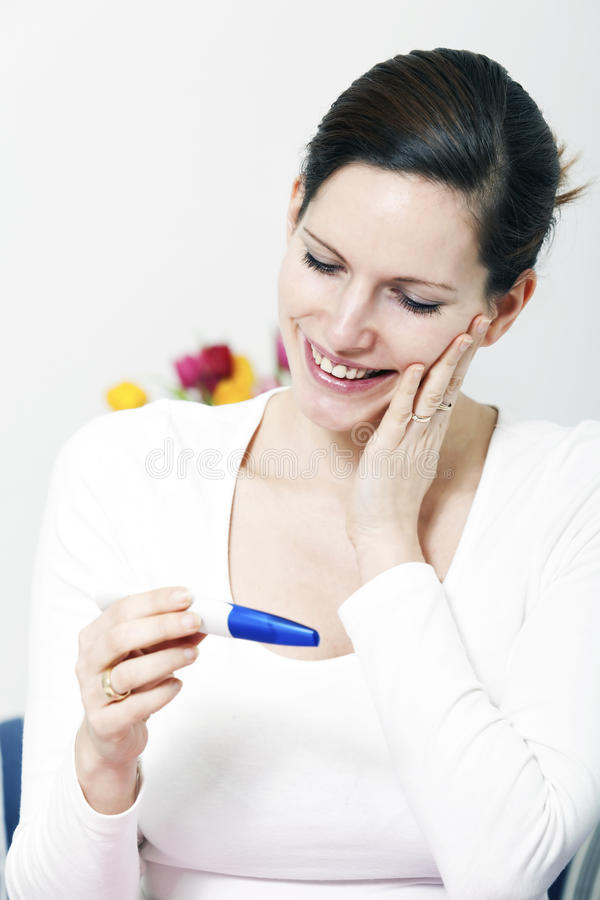 Happy woman with positive pregnancy test stock photos