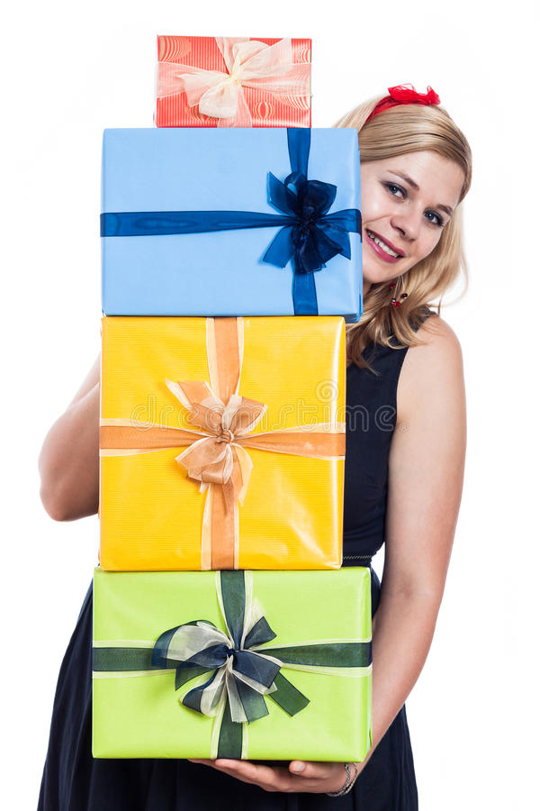 Happy woman with presents. Happy woman holding many colorful presents, isolated on white background royalty free stock images