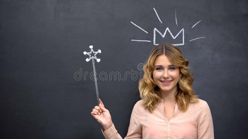 Happy woman pretending to be fairytale princess with mystery wand, female dreams stock image