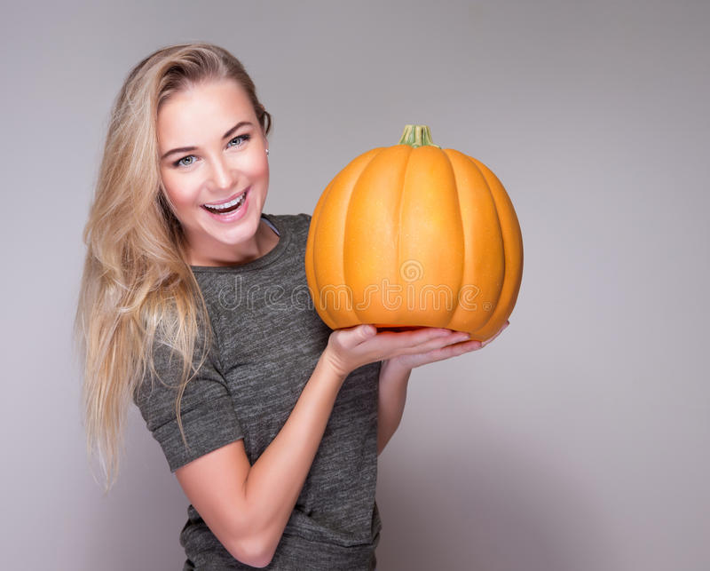 Happy woman with pumpkin royalty free stock images