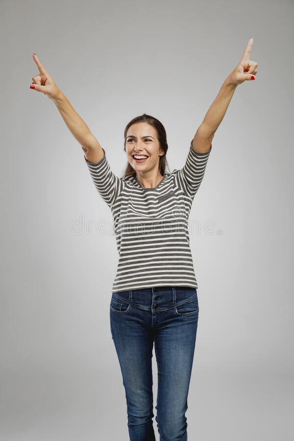 Happy woman raised arms royalty free stock images