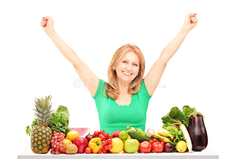 Happy Woman With Raised Hands Posing With Pile Of Fruits And Veg Royalty Free Stock Photography