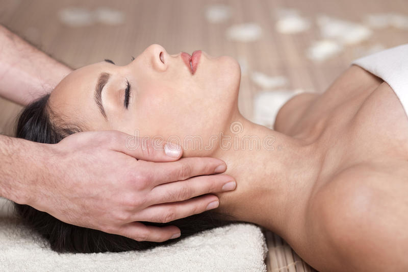 Happy woman receiving head massage royalty free stock photography