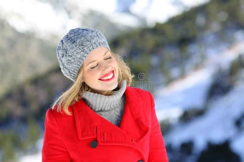 Happy woman with closed eyes enjoying winter holiday royalty free stock image
