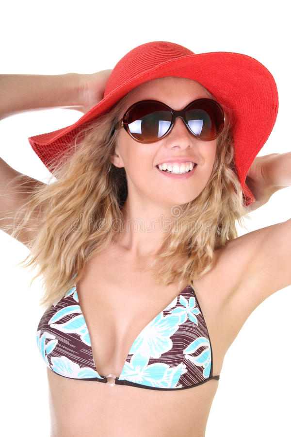 Happy woman in red hat and sunglasses