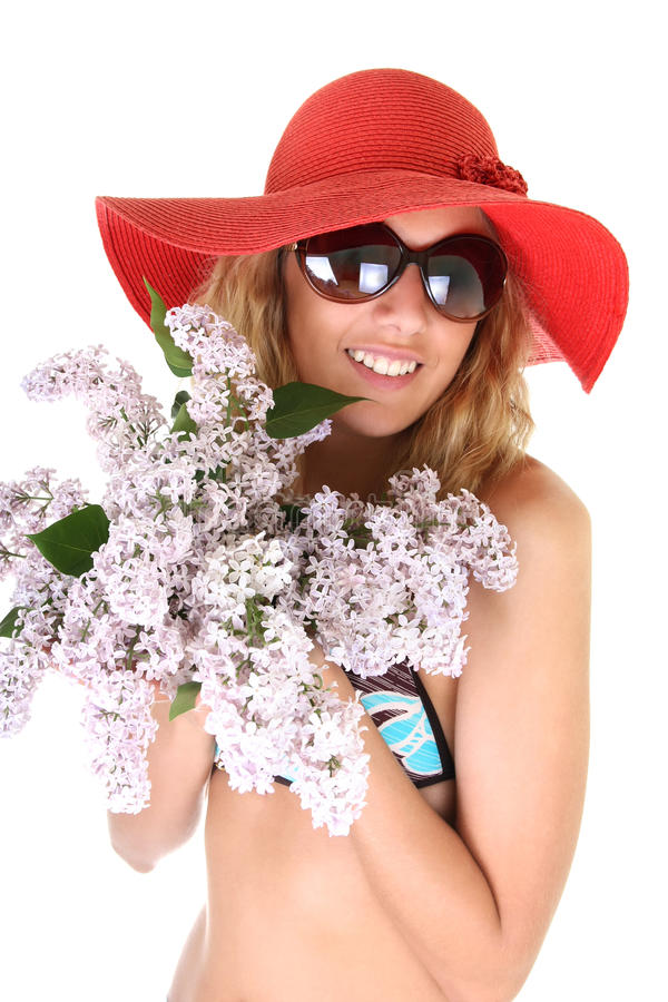 Happy woman in red hat and sunglasses with lilac