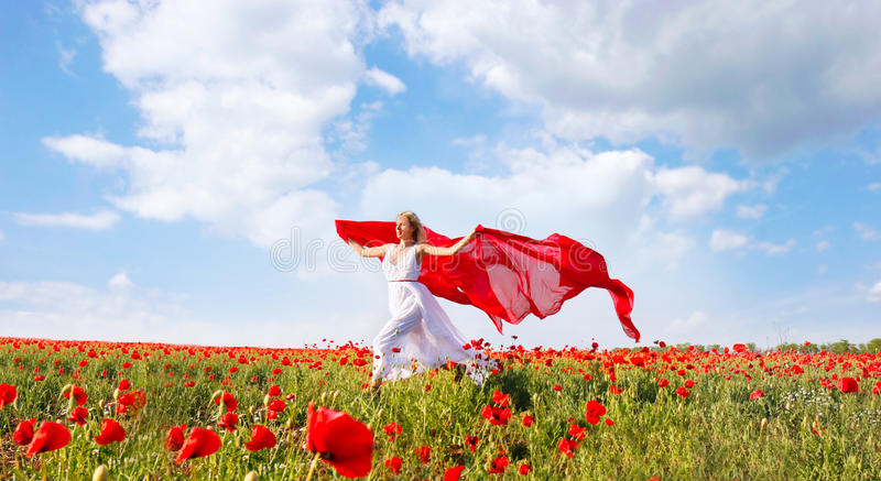 Download Happy Woman With Red Scarf In Poppy Field Stock Photo - Image: 10512100