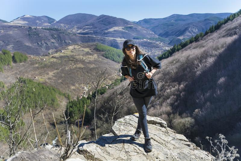 Happy Woman in a High Mountain. Happy woman relaxing in a high mountain royalty free stock photos