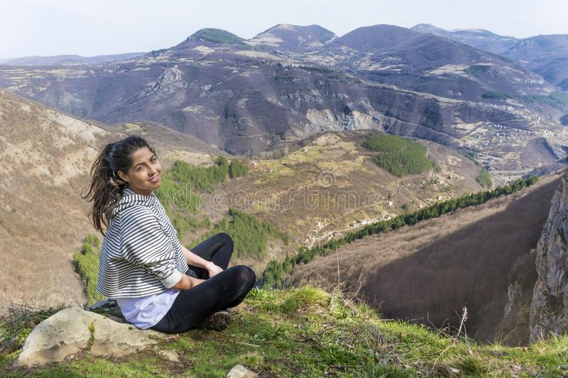 Happy Woman in a High Mountain. Happy woman relaxing in a high mountain stock photo