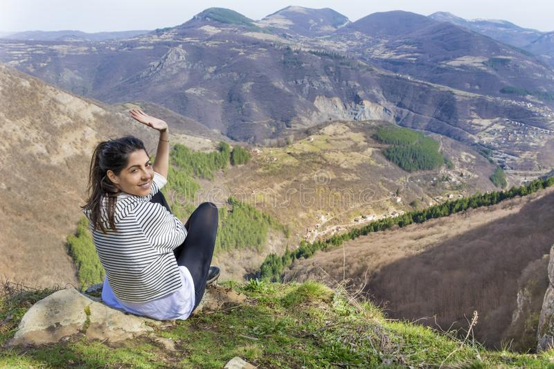 Happy Woman in a High Mountain. Happy woman relaxing in a high mountain stock photography