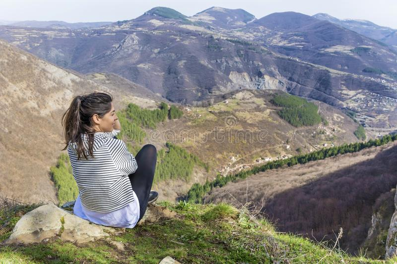 Happy Woman in a High Mountain. Happy woman relaxing in a high mountain stock photos