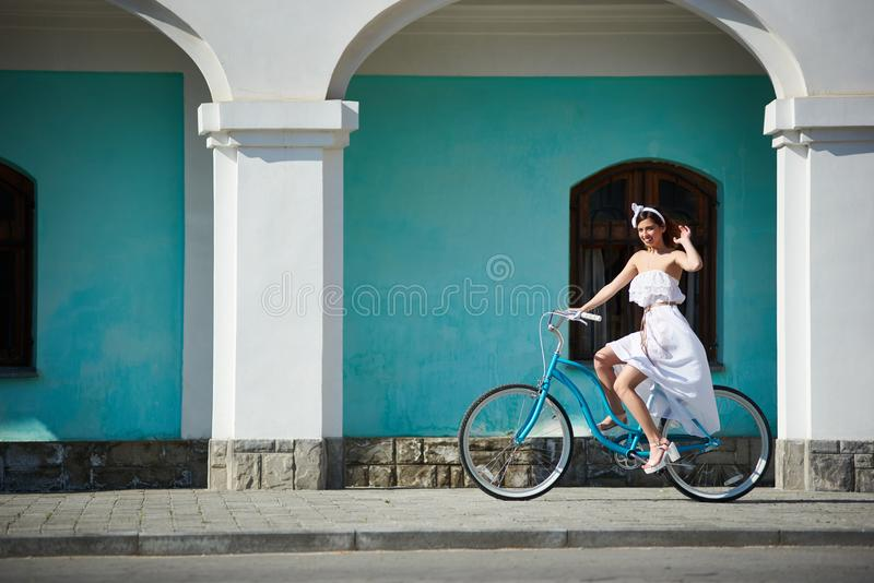 Happy woman is riding retro bike in hot summer day royalty free stock photography