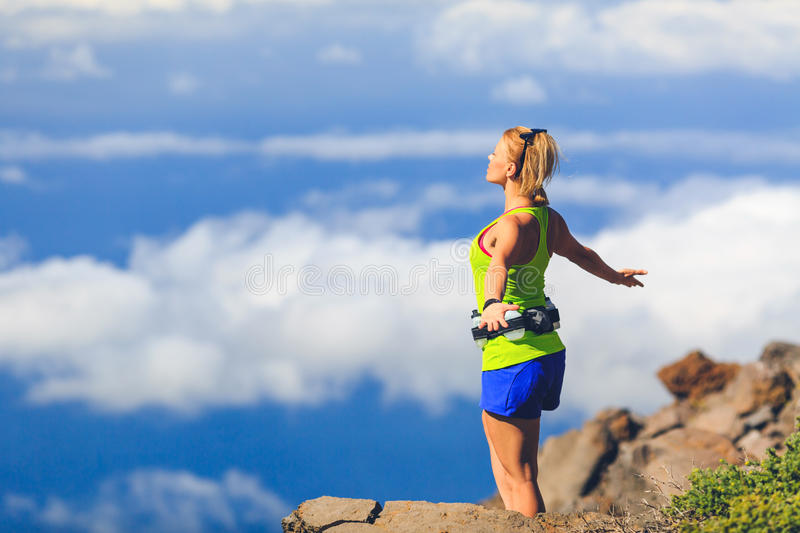 Happy woman runner arms raised outstretched freedom royalty free stock photos