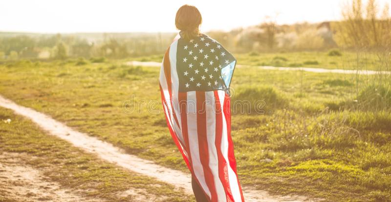 Women running in the field with American flag USA celebrate 4th of July. Happy woman running in the field with American flag USA celebrate 4th of July stock photography