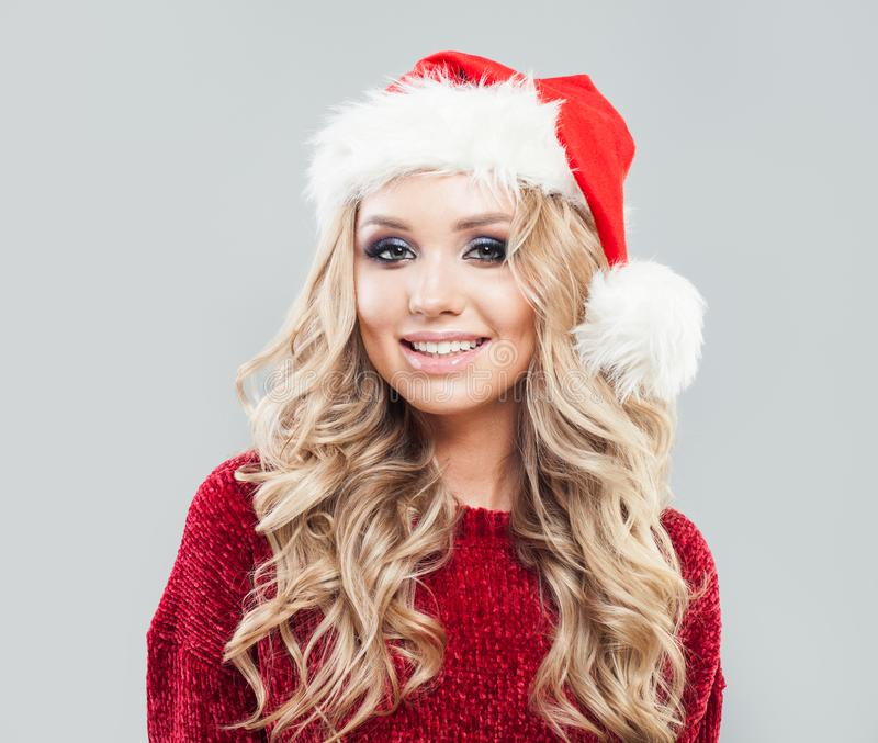 Happy woman in santa hat portrait. Christmas and New Year party. royalty free stock images